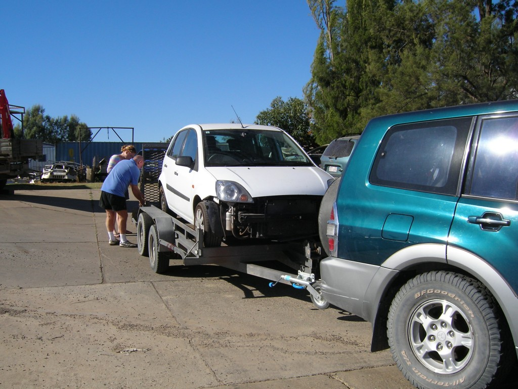 The broken car loaded onto the trailer